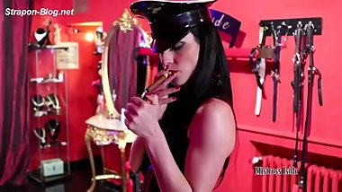 mistress in latex smokes cigar and fucks her slaves asshole