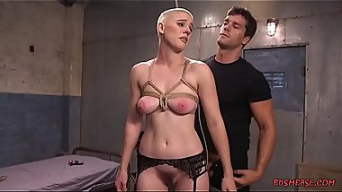 Short haired blonde with nice natural tits gets tied up and fucked