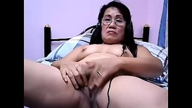 Ugly asian granny masturbates on webcam