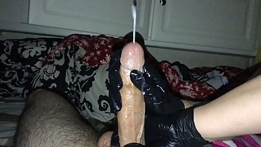 Big squirt with black latex gloves hand job