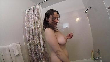 Busty natural Cara Banx shaking her tits in slow motion