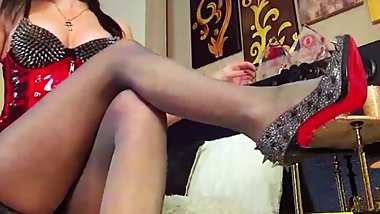 Goddess T. putting on her shiny pantyhose and heels