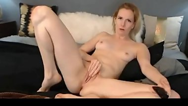 Horny blonde masturbating with a realistic dildo and a magic wand