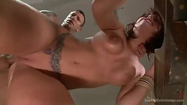 Sexy bound redhead deep throats cock before rough pussy and ass pounding.