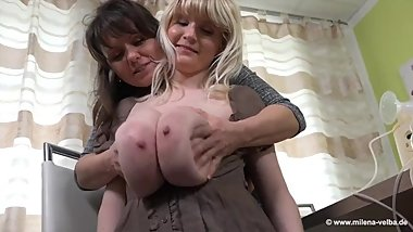 MILFs Sucking Each Other Huge Milk Filled Tits