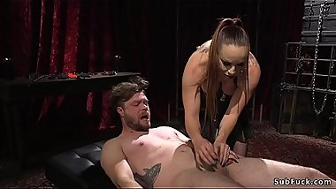 Mistress rides gag dick on males face