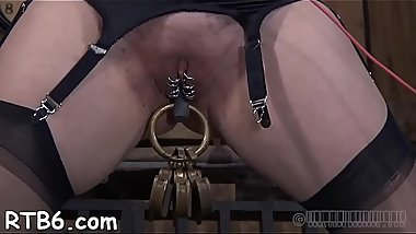 Tied up slave receives tight mask with hard toy in her impure cleft