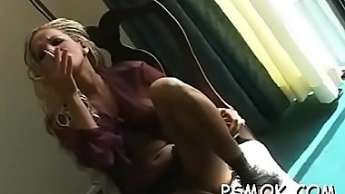 Tempting slut puts a sex toy unfathomable into her juicy pussy