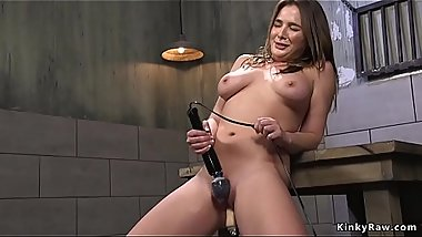 Busty wet brunette rides Sybian