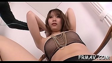 Japanese darling amazes two cocks with randy oral pleasure