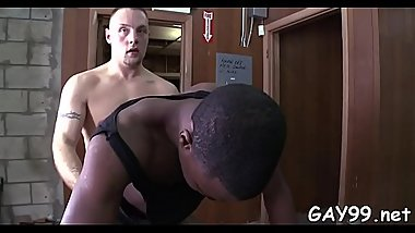 Muscle ebony gay dude likes feeling white meat in his anal