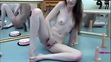 Brunette babe with bush fingers her ass and sucks on dildo