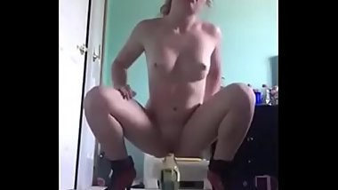 Amateur chav babe riding wine bottle